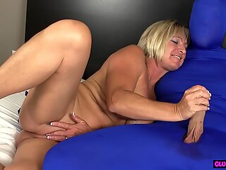 Mature beauty tugging dick during CFNM