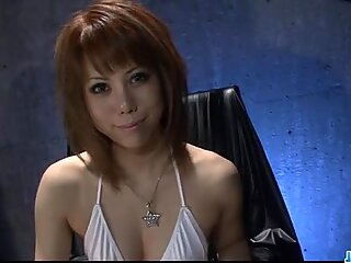 Red-haired japanese beast sensually plays with her fingers on the labia and clitoris.