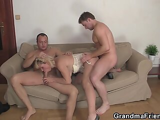 Hot blonde mommy swallows two cocks at once