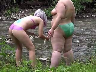 Hairy lesbians with big asses in the natural environment. Fetish with peeping behind the scenes and body art outdoors.