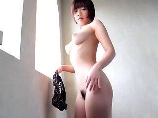 Mana Sakura beautiful Japanese posing naked by window