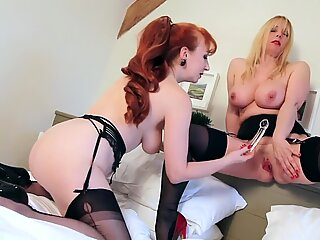 crimson and Lucy push multiple toys in their labia