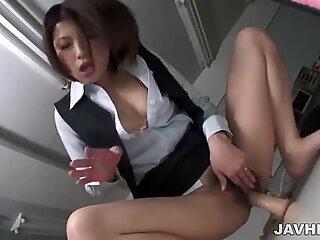 Horny Japanese cutie Kaoru Natsuki plays with a rubber cock.